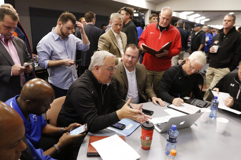 Steve Bragg, center, Mesquite ISD athletic director, leads discussions during the realignment of schools at the Birdville Fine Arts Complex in North Richland Hills on Monday, February 1, 2016. (David Woo/The Dallas Morning News)