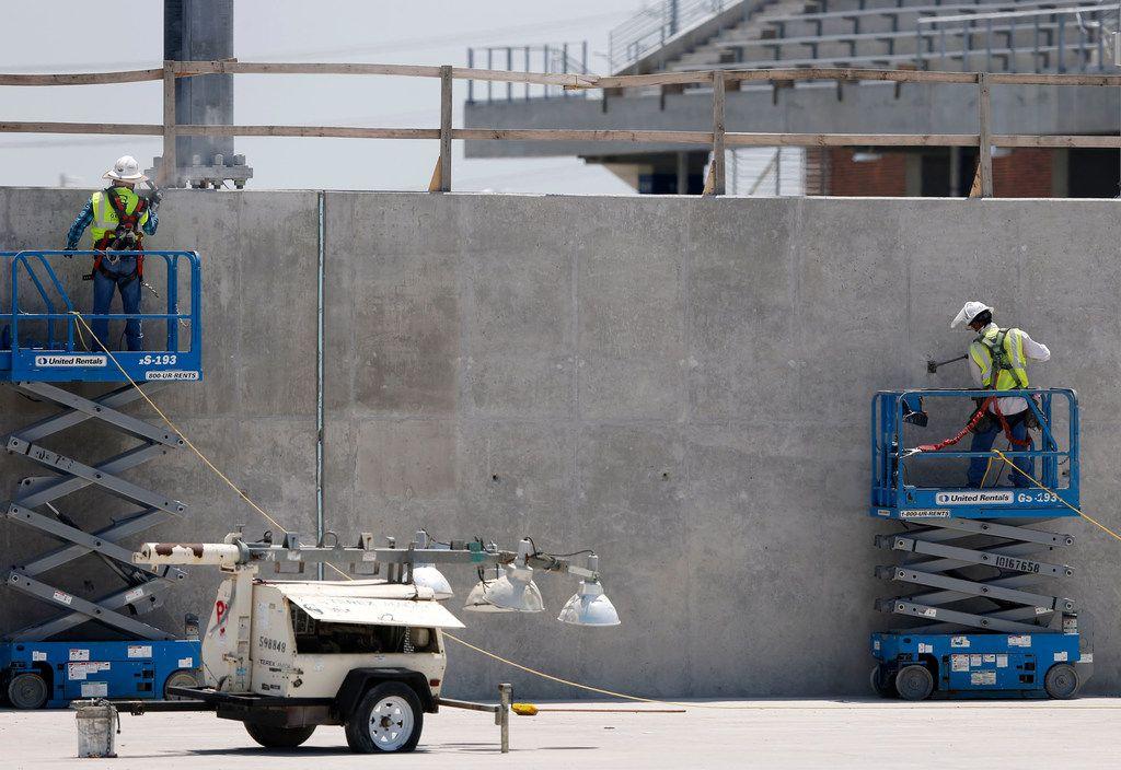 Construction continues at McKinney ISD Stadium on Friday. (Vernon Bryant/Staff Photographer)