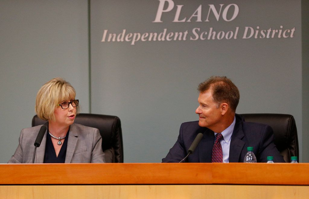 Plano ISD Superintendent Brian Binggeli receives compliments from board president Missy Bender after his resignation was accepted in the Plano ISD boardroom in Plano, Texas, on Nov. 28, 2017.