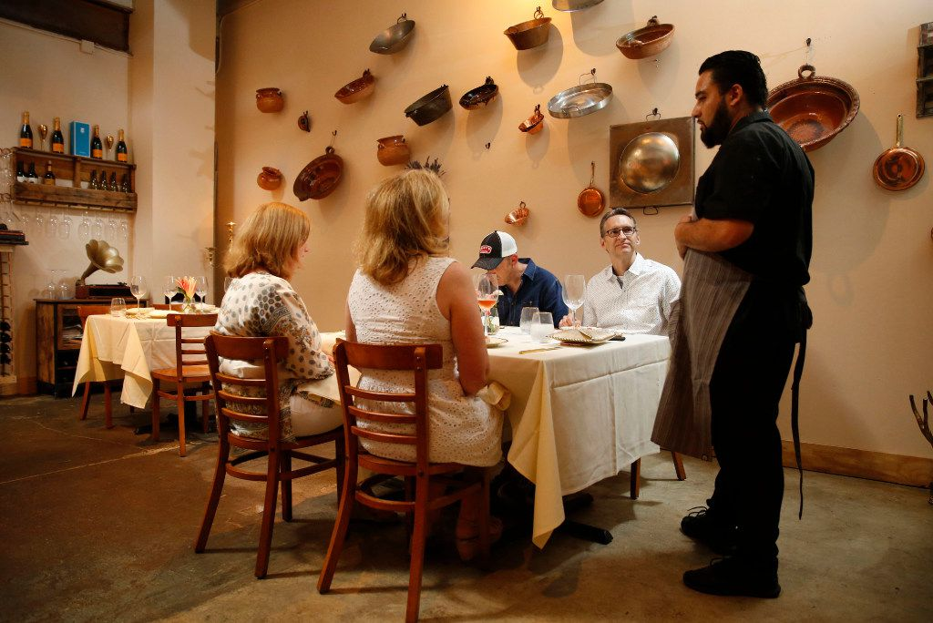 Chef-owner Regino Rojas explains the next course to diners in Revolver Taco Lounge's Purepecha Room. (Vernon Bryant/The Dallas Morning News)