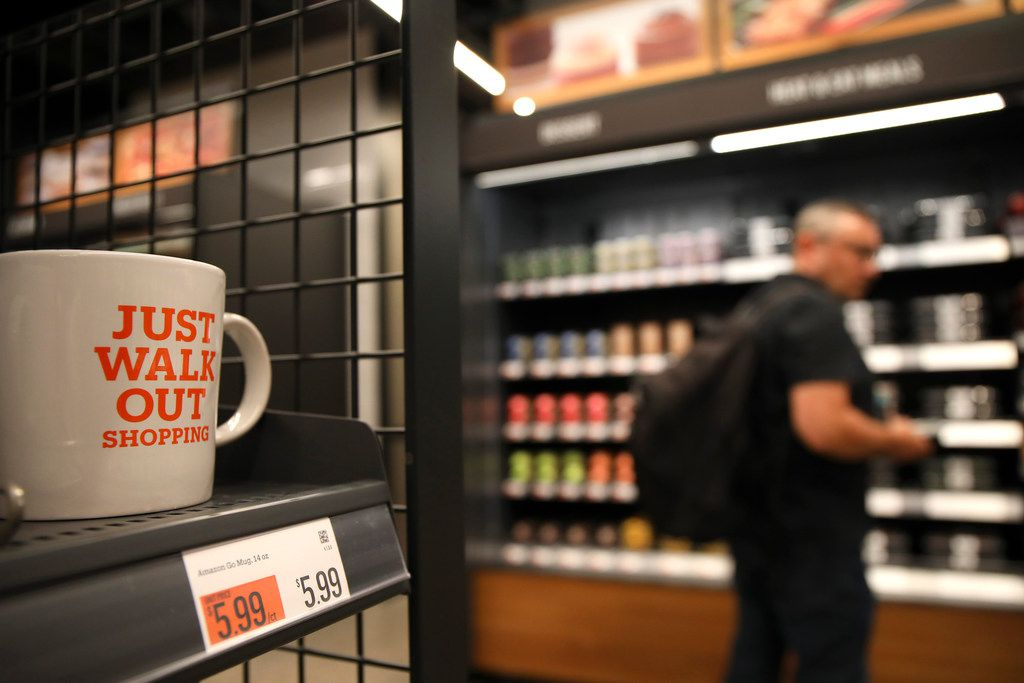 Peter Feldman, black shirt, shops at the new Amazon Go store on the 100 block of South Franklin Street on Monday, Sept. 17, 2018 in Chicago, Ill. (Stacey Wescott/Chicago Tribune/TNS)