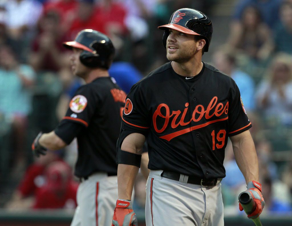 Baltimore Orioles first baseman Chris Davis (19) reacts after striking out against Texas Rangers starting pitcher Derek Holland (45) in the second inning of MLB Baseball action at Rangers Ballpark in Arlington, Texas on Friday, July 19, 2013.   (Brad Loper/The Dallas Morning News)