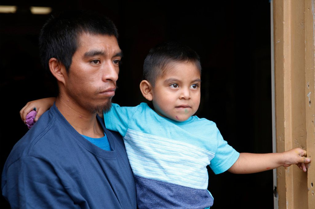 Pablo Ortiz, 28, with his son Andres, 3, speaks to at the Annunciation House in El Paso on Wednesday. He had not seen his son since April.