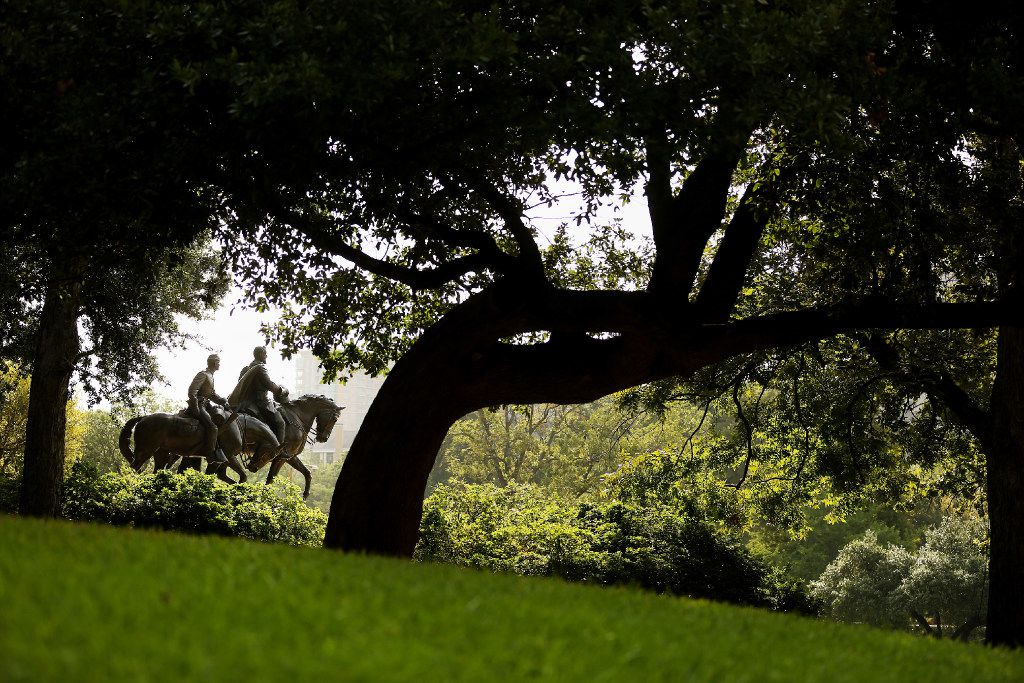 A view of the statue of Confederate Gen. Robert E. Lee at Robert E. Lee Park in the Oak Lawn neighborhood of Dallas on Wednesday. Dallas mayor Mike Rawlings called for a task force to study the issue of whether or not to remove the city's Confederate monuments in Lee Park and Pioneer Plaza. The task force has 90 days to report their findings. The statue was unveiled by President Franklin D. Roosevelt on June 12, 1936.