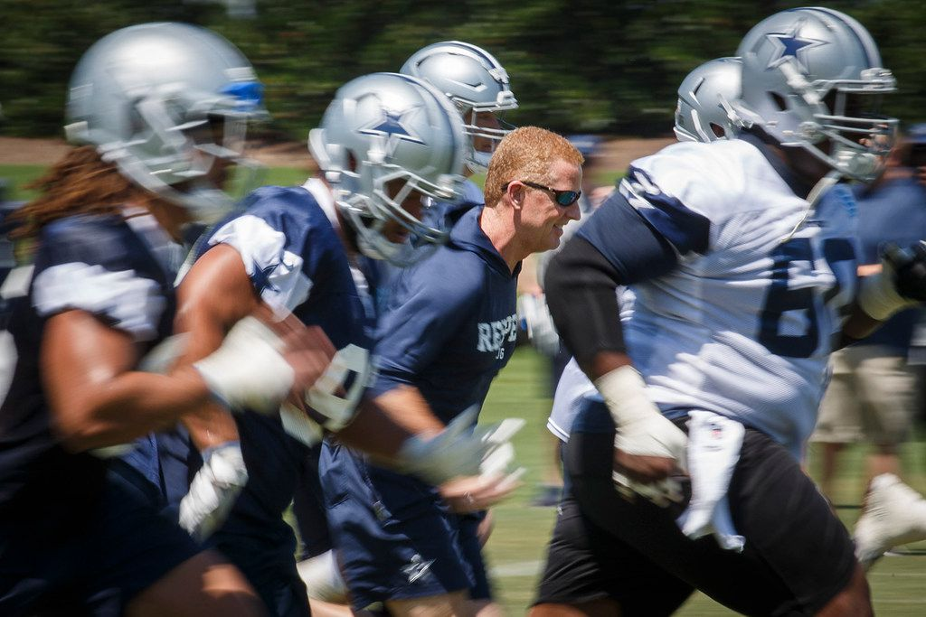 FILE - Dallas Cowboys head coach Jason Garrett runs sprints with his players during the third and final round of Cowboys OTA practices at The Star on Wednesday, June 6, 2018, in Frisco. (Smiley N. Pool/The Dallas Morning News)