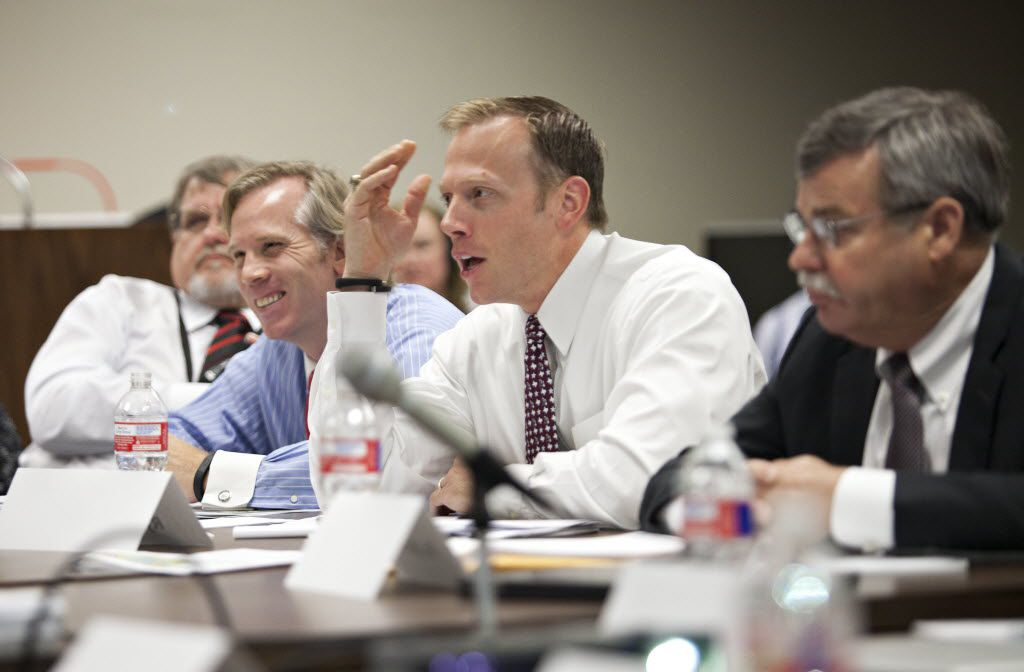 Railroad Commissioner Ryan Sitton speaks with seismologists from SMU, UT-Austin and the U.S. Geological Survey as they spoke before the Railroad Commission about their study of recent quakes in Azle and Reno at a panel in Austin, Texas on May 5, 2015. To his left is Jared Craighead and to his right is Dr. Dan Hill, who is the department head of Texas A&M's Petroleum Engineering department.