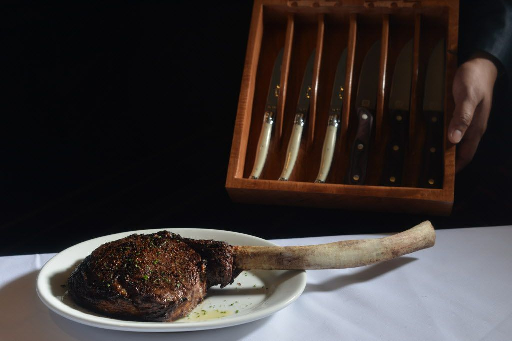 The tomahawk ribeye with a choice of knives at Ruth's Chris Steak House opening on Cedar Springs Road in Dallas on Thursday, Nov., 5, 2015. (Rachel Woolf/The Dallas Morning News)