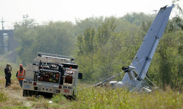 Investigators worked the scene of a plane crash in Carrollton on Monday.