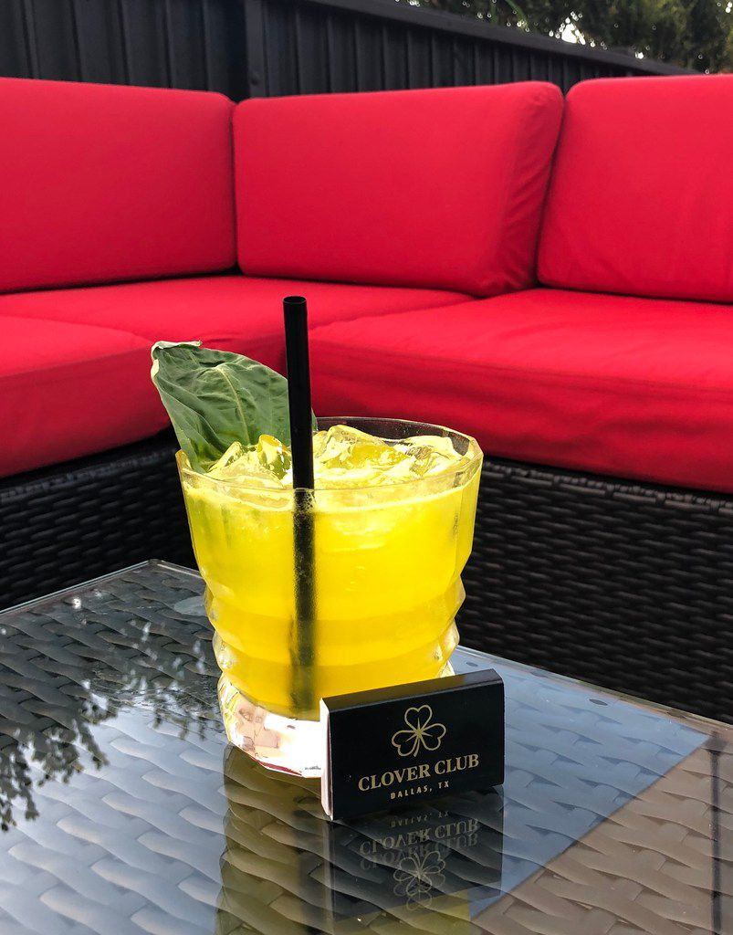 Clover Club supper club opened in summer 2019 on Cedar Springs Road in Uptown Dallas. This cocktail is a vibrant yellow from a dash of turmeric.