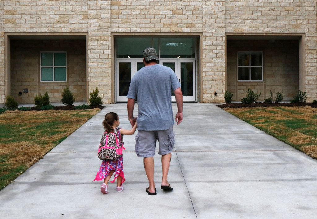 Brandon Crain walked his daughter Grace, 3, to her pre-K class on the first day of school at University Park Elementary School on Monday. (David Woo/Staff Photographer)