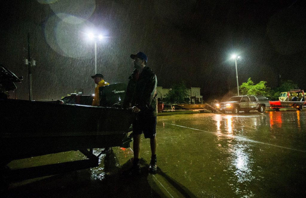Volunteers set up a boat for a rescue as Hurricane Harvey hit landfall for a second time on Tuesday, August 29, 2017 at Central Fire Station in Lumberton, Texas. (Ashley Landis/The Dallas Morning News)