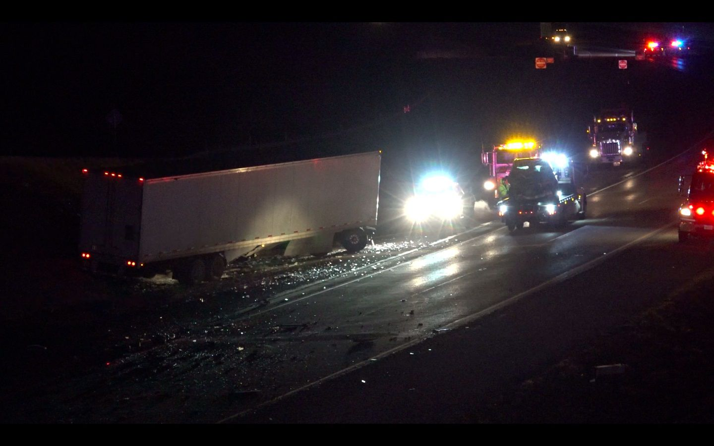 An 18-wheeler rests along the side of State Highway 287 in Rhome after it struck a guardrail that became dislodged from a previous crash and wound up in the road.