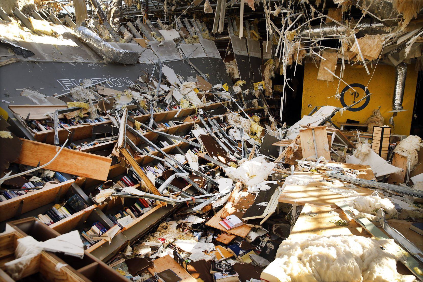 The interior of the Interabang Books store was demolished by a tornado Oct. 20, 2019, in the Preston Royal shopping center in Dallas.