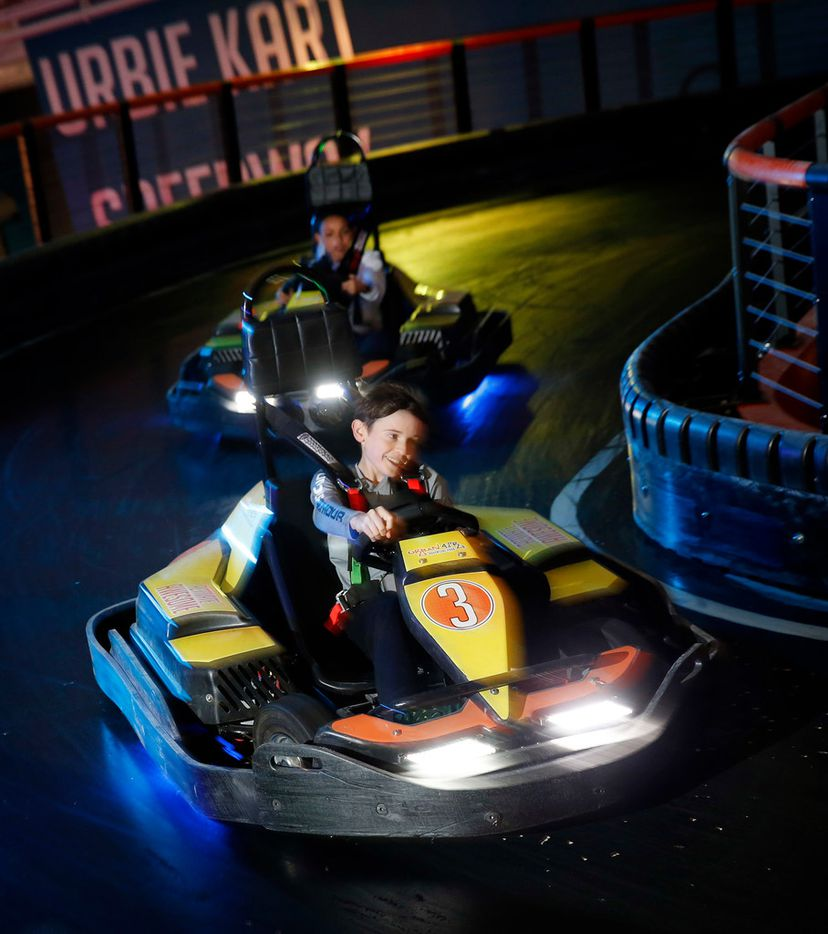 Austin Thomas, 15, (front) and Isaac Thomas,12, of Keller race on the Urban Kart Speedway inside Urban Air Adventure Park's location in Southlake.