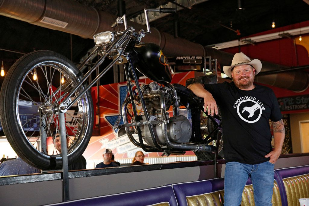 Randy Rogers poses with a motorcycle that is on the menu for $25,000 as a joke at ChopShop Live in Roanoke.