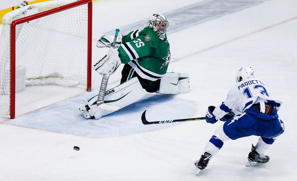 Tampa Bay Lightning forward Cedric Paquette (13) is unable to reach a pass as Dallas Stars goaltender Anton Khudobin (35) slides over to defend during the second period of an NHL hockey game, Tuesday, Jan. 15, 2019, in Dallas. (AP Photo/Brandon Wade)
