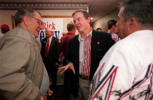 In this 1998 file photo,  Rep. Joe Barton talks with citizens  of Waxahachie during a campaign rally for Rick Perry.