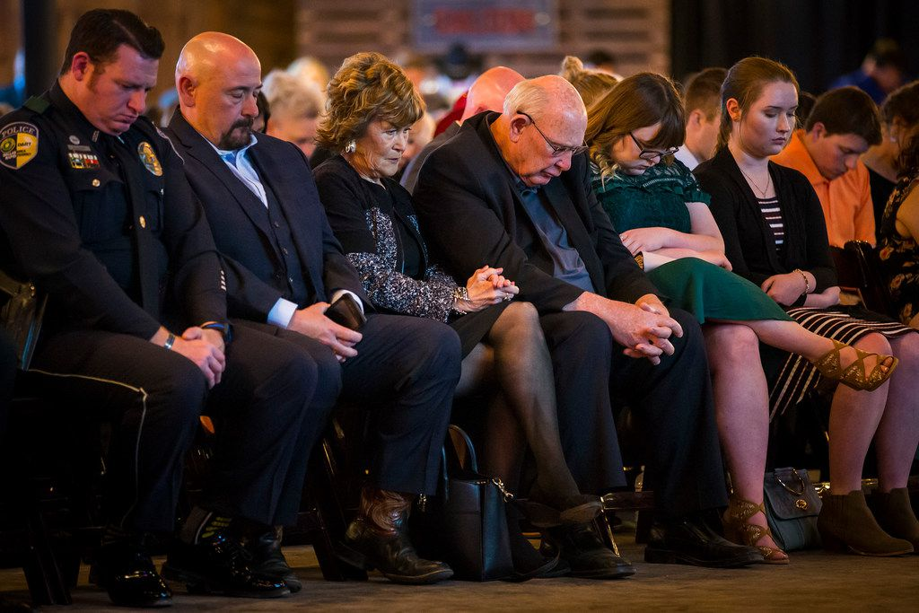 The family of fallen DART Police Officer Brent Thompson bows their heads in prayer during a campaign event for Sen. Ted Cruz at River Ranch Stockyards on Wednesday, April 4, 2018, in Fort Worth, Texas.