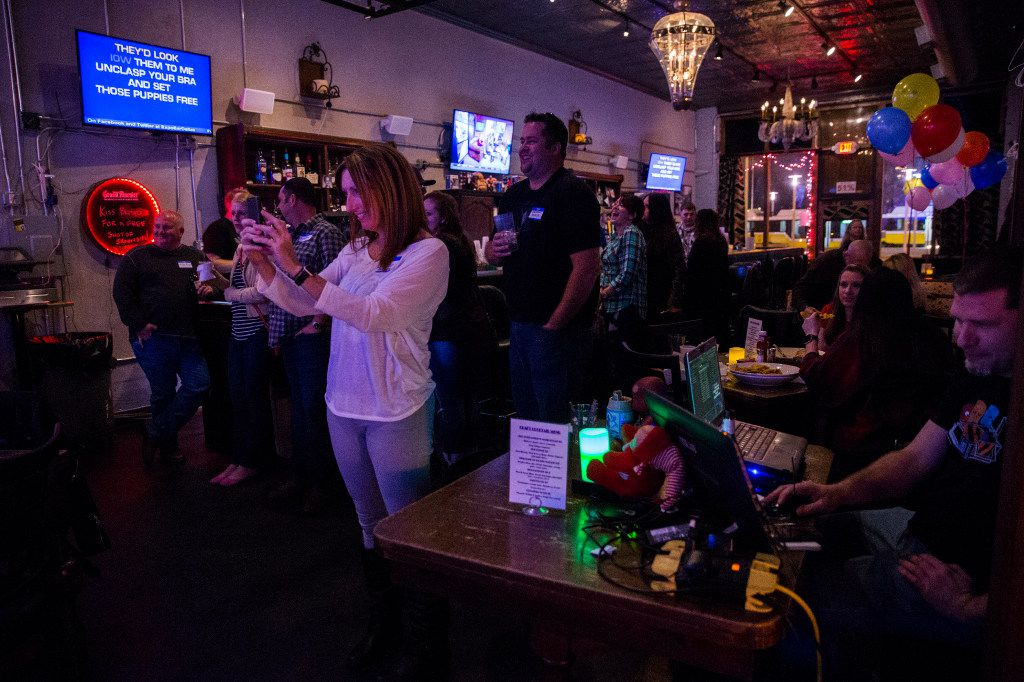 People watch karaoke at Expo Bar Dallas across the street from Fair Park on Saturday, January 28, 2017 on Parry Avenue in Dallas.