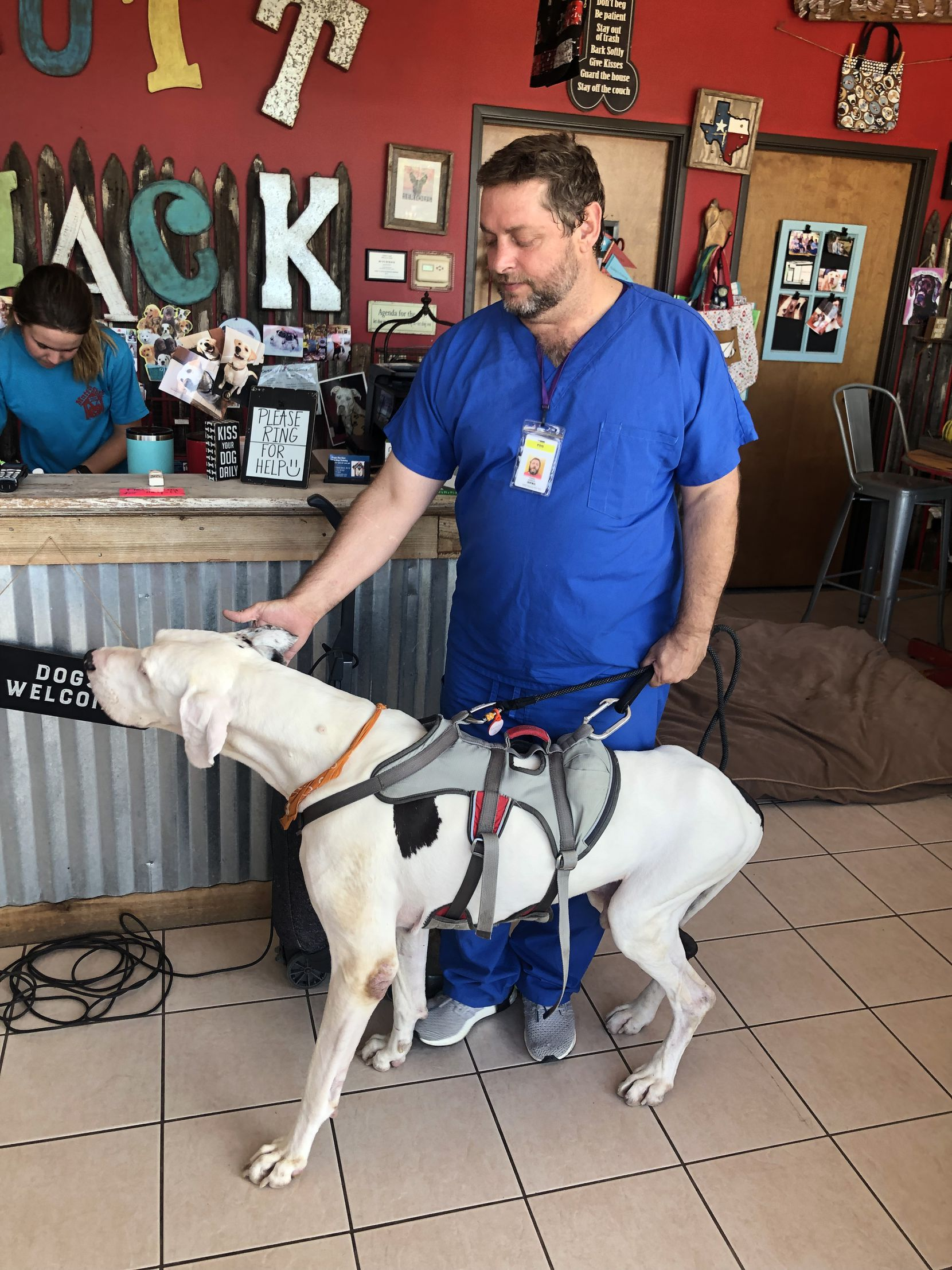 Todd Johnson picking up Samson at the now-closed Mutt Shack after a day of work. The man and his dog energized a community to get involved.