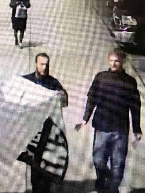 Two people from the group were seen carrying a banner at Park Cities Plaza after midnight Saturday.