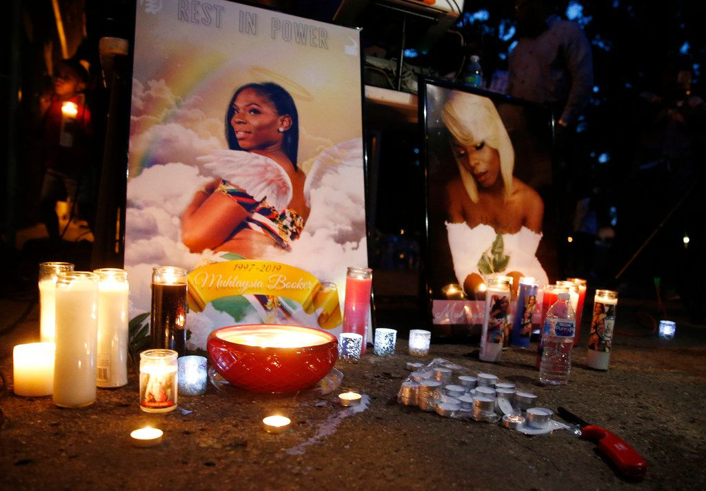 Candles lit next to photos of Muhlaysia Booker during a candlelight vigil for her in Dallas, on Wednesday, May 22, 2019. Booker, a transgender woman, was the victim of assault at an apartment complex in east Oak Cliff in April. Booker was found dead in Far East Dallas on Saturday. (Vernon Bryant/The Dallas Morning News)