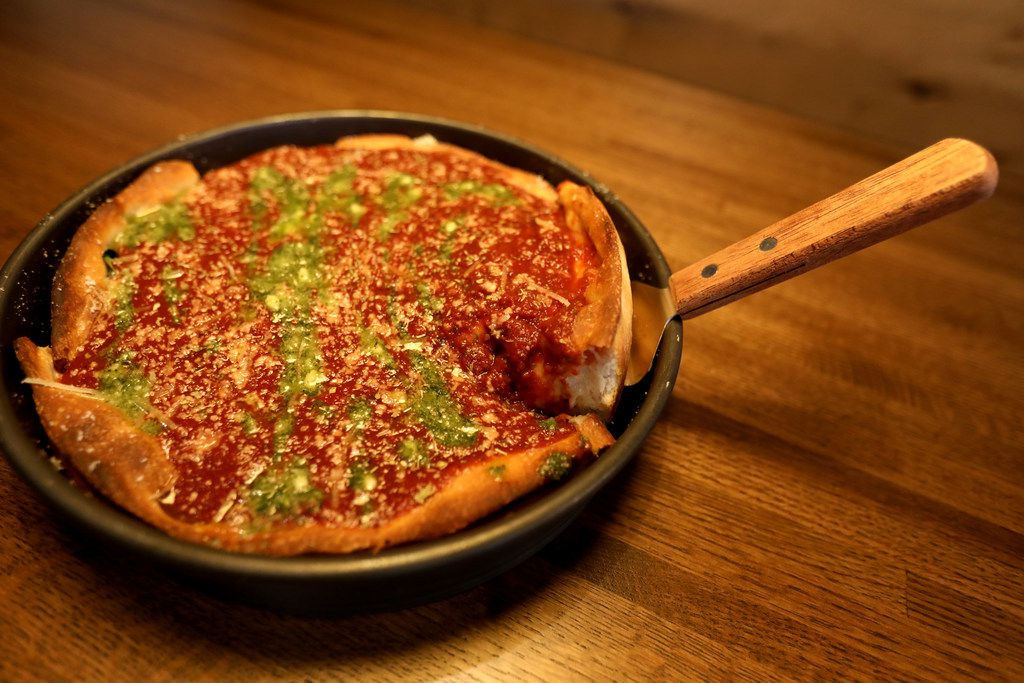 The Windy City Deep Dish Pizza, with spinach, garlic, chicken, tomatoes and mozzarella, topped with fresh crushed tomato sauce, oregano, parmesan, feta and pesto, at the new restaurant, Rotolo's Craft & Crust, in Frisco, Texas Saturday, Sept. 29, 2018. (Anja Schlein/Special Contributor)