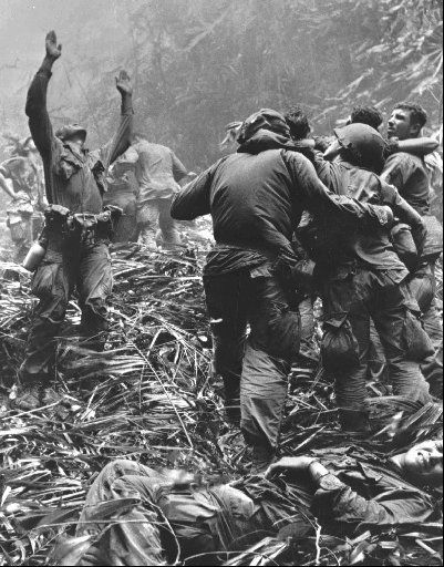 A paratrooper of A Co., 101st Airborne Division, guides a medical evacuation helicopter into a gap in the jungle to pick up men who were wounded during a patrol into North Vietnamese-controlled territory west of Hue in Vietnam in 1968.
