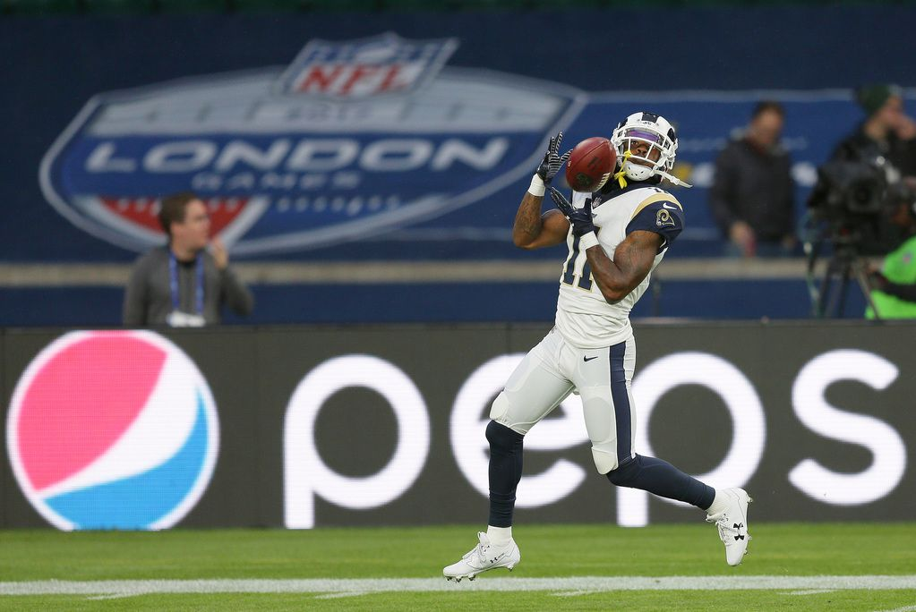 FILE - In this Oct. 22, 2017, file photo, Los Angeles Rams wide receiver Tavon Austin (11) catches the ball as he warms-up for an NFL football game against Arizona Cardinals at Twickenham Stadium in London. An NFL team in London? An NBA franchise in Mexico City? We're drawing closer to the day when a team from those leagues puts down roots outside the United States and Canada. (AP Photo/Tim Ireland, FIle)