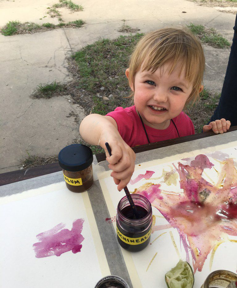 Kara Wigzell, 2, of Dallas paints with natural dyes at The MAC POP Garden open house.