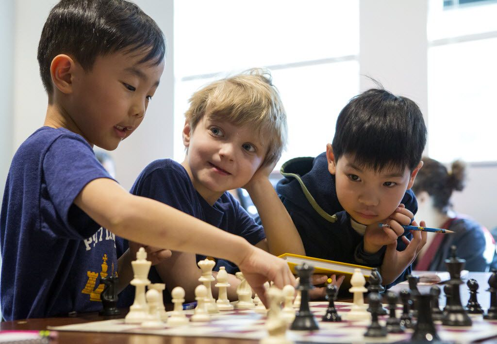 From left: Benjamin Kwon, Davin Friedman and Cooper Reid Dong review a position from a recent game during a chess tournament in New York. Chess is enjoying a boom in the New York area, much of it because schools have brought the game to very young players.