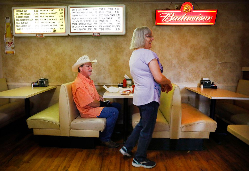 Candace Warden shares a laugh with diner Danny McDonald at Green's Sausage House in Zabcikville, Texas. McDonald has been going to Green's ever since he was a kid.