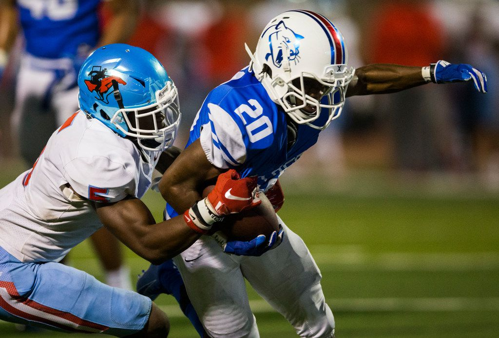 Duncanville running back Cameron Gray (20) is tackled by Skyline defensive back Isaiah Nwokobia (5) during the fourth quarter of a high school football game between Skyline and Duncanville on Friday, October 4, 2019 at Panther Stadium in Duncanville. (Ashley Landis/The Dallas Morning News)