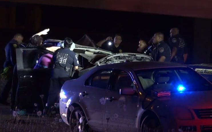 Dallas County Sheriff's Department personnel examine a pickup that crashed into a bridge support Wednesday night near Mesquite. The driver was killed.