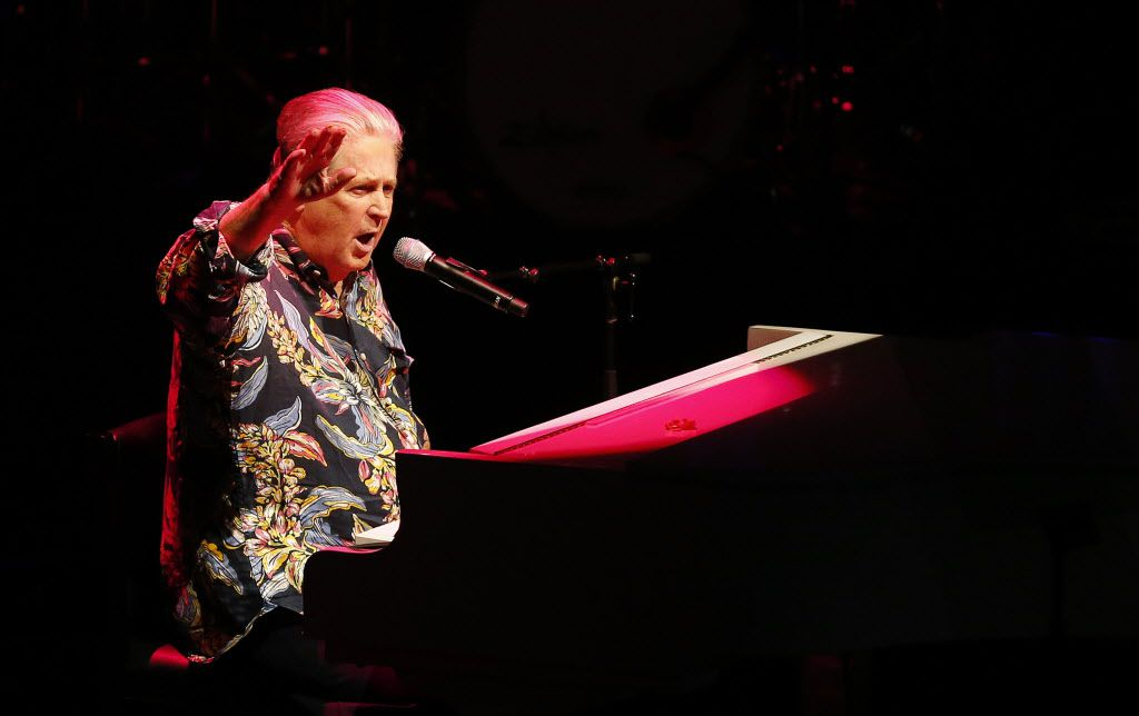 Beach Boys founding member Brian Wilson salutes the crowd as he performs at Verizon Theatre in Grand Prairie, Texas, Wednesday, June 24, 2015.