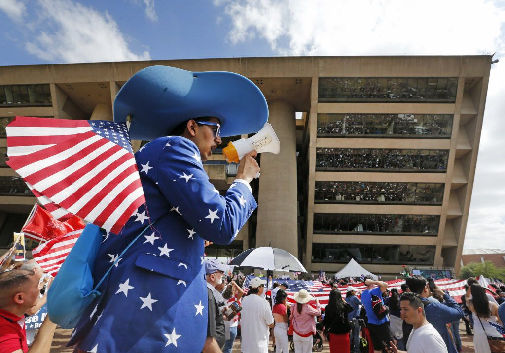 Bhavik Patel lends his voice to the gathering at City Hall plaza after the Mega March, which started at the Cathedral Shrine of Our Lady Guadalupe in downtown Dallas, photographed on Sunday, April 9, 2017.