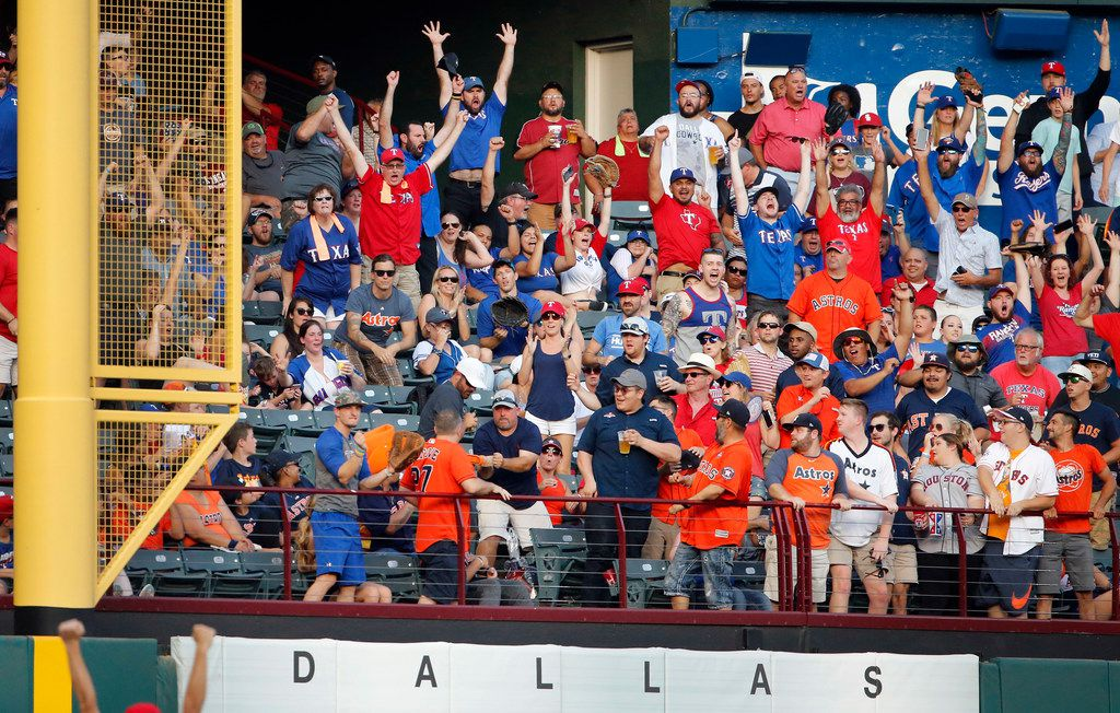 Texas Rangers fans cheers as batter Shin-Soo Choo's home run ball clears the left field wall in the first inning against the Houston Astros at Globe Life Park in Arlington, Texas, Saturday, July 13, 2019.  (Tom Fox/The Dallas Morning News)