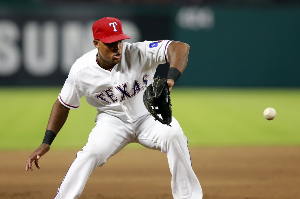 Texas Rangers third baseman Adrian Beltre (29) fields a ground ball hit by New York Yankees batter Ronald Torreyes to end the top of the eighth inning at Globe Life Park in Arlington, Tuesday, April 26, 2016. The Rangers won, 10-1. (Tom Fox/The Dallas Morning News)
