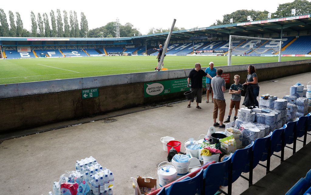 A general view of Gigg Lane stadium home of Bury Football Club, as volunteers help clean up the stadium in Bury, England, Tuesday, Aug. 27, 2019. Bury FC are almost certain to be expelled from the third tier of English soccer after a proposed takeover by C&N Sporting Risk fell through on Tuesday, just 90 minutes before a league-set deadline for the deal to be completed. The League One club's owner Steve Dale was originally given until midnight on Friday to prove he could pay off Bury's debts and fund the next two seasons or find someone who could. (AP Photo/Alastair Grant)