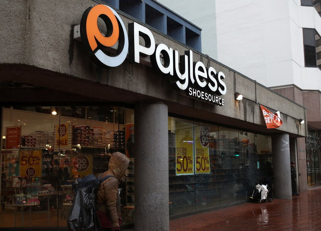 SAN FRANCISCO — A pedestrian walks by a Payless Shoe store on Feb. 8. Payless is preparing to file for a second bankruptcy and shutter its North American stores.