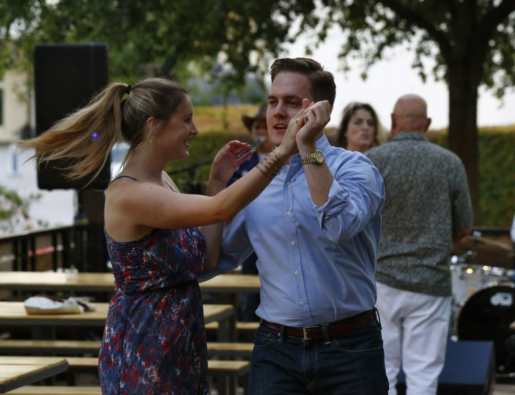 Katie Allen (left) and Steve Bolner dance during the opening party of Hickory.