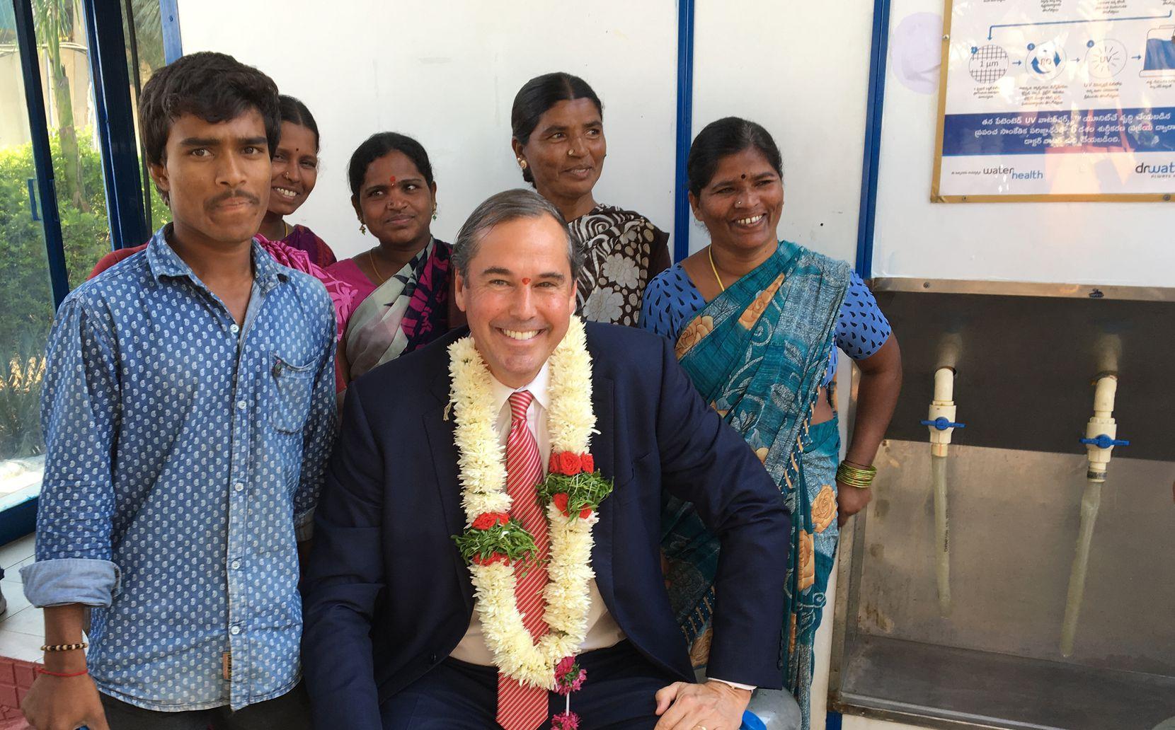 Ray Washburne visits a WaterHealth machine in India.