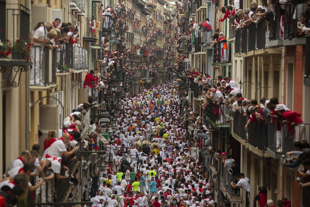 Revellers run with Puerto de San Lorenzo's fighting bulls during the second day of the San Fermin Running of the Bulls festival.