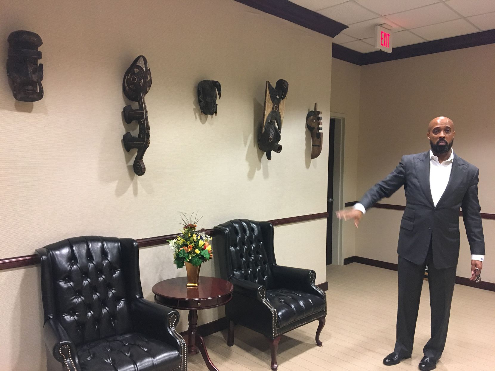 The Rev. Frederick Haynes III shows some of the African art pieces that Dallas County Commissioner John Wiley Price donated to his Friendship-West Baptist Church.