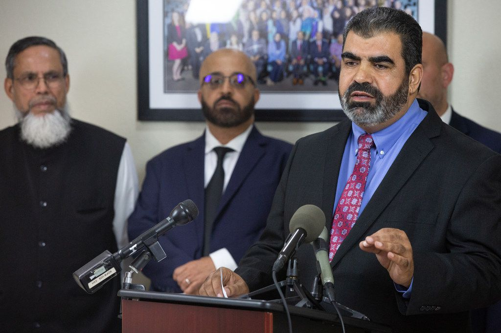 Muslim community leader Abderraoof Alkhawaldeh (right) spoke  during a press conference at the Council on American-Islamic Relations office in Dallas on Thursday. Alkhawaldeh and another Muslim community leader, Issam Abdallah (second from left), said they were profiled and discriminated against during a recent American Airlines flight in Alabama.