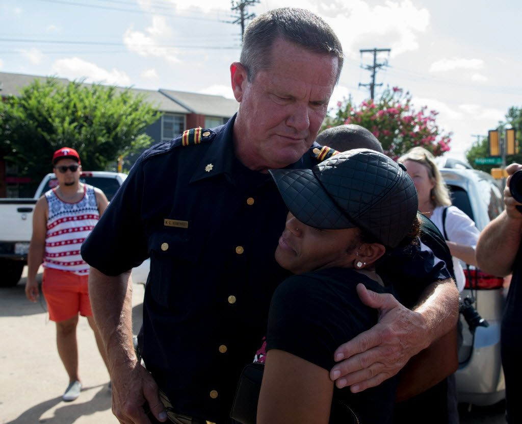 Officer W.C. Humphrey embrace with Kristen Duncan, 25, of Arlington, Texas during the Black Lives Matter rally at the corner of Park Ln and Ridgecrest Rd on July 10, 2016 in Dallas. (Ting Shen/The Dallas Morning News)