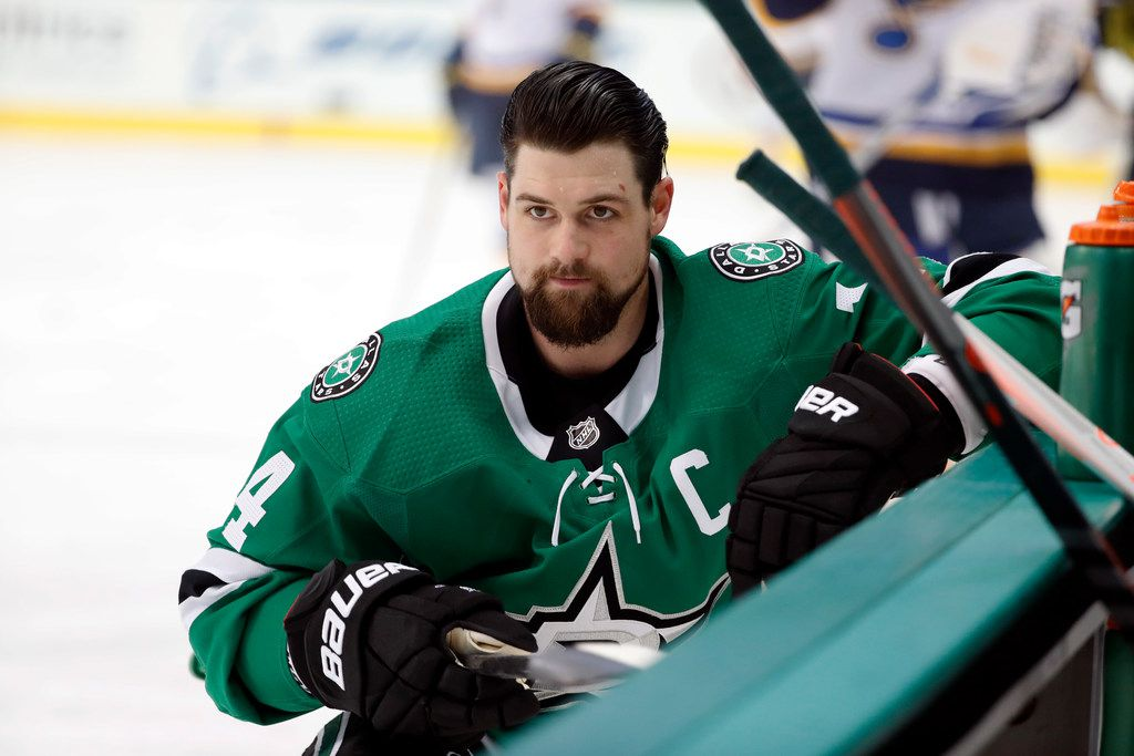 Dallas Stars left wing Jamie Benn (14) stretches by the bench during warm ups before an NHL hockey game against the St. Louis Blues in Dallas, Thursday, Feb. 21, 2019. (AP Photo/Tony Gutierrez)