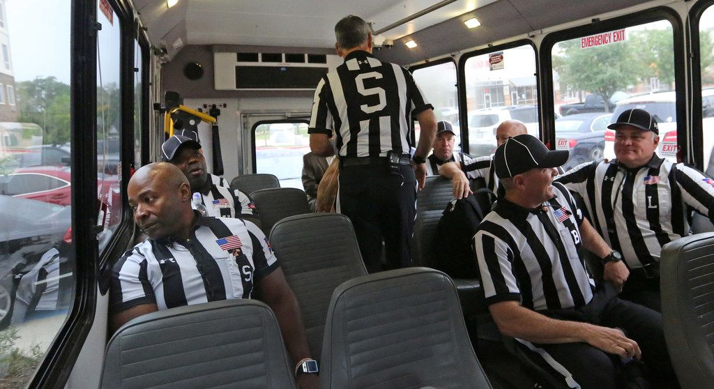 The SEC officiating crew boards the bus to go to the stadium before the  Louisiana Lafayette Ragin' Cajuns vs. the Texas A&M Aggies at Kyle Field in College Stadium, Texas on Saturday, September 15, 2017. (Louis DeLuca/The Dallas Morning News)
