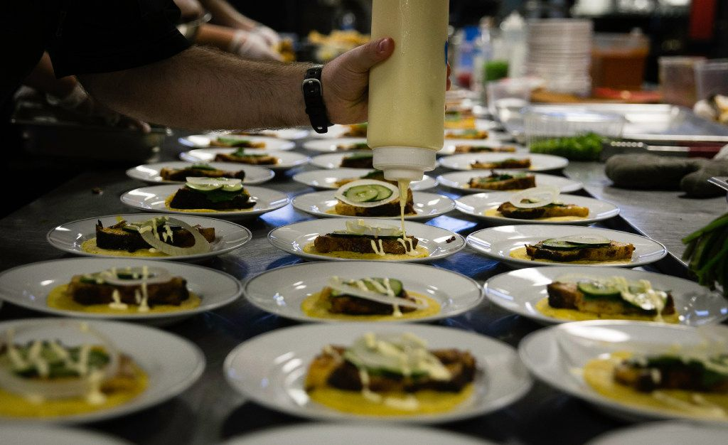 Plates are prepared during the supper club dinner at Magdalena's  in Fort Worth.