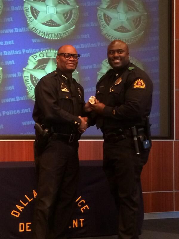 Aaron Bell (right) was promoted to lieutenant in 2013 by Chief David Brown.